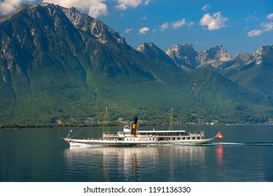 GENEVA, Switzerland -  September 5, 2018: cruise steamer on Lake Geneva against the background of beautiful mountains and reflection in the water