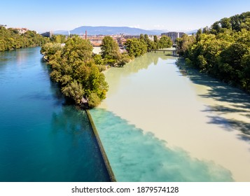 Geneva, Switzerland - September 8, 2020: The Junction is the name of the confluence where the emerald blue waters of the Rhone river and the yellowish silty waters of the Arve river blend.