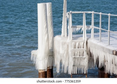 Geneva, Switzerland, wind and the very low temperatures created a winter wonderland on the Geneva lake. the stake are covered with ice