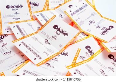 Geneva/Switzerland – 03.03.2019 : Many losing lottery ticket receipt Swiss loto paper win