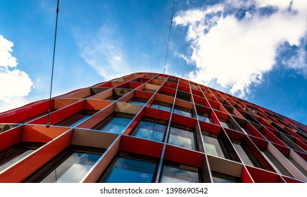 Geneva/Switzerland - April 10th 2019:  Building with sky reflection