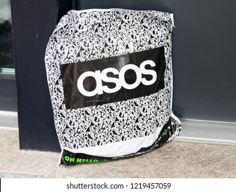 Geneva/Switzerland-10.08.18: Asos online shopping package logo  house door handle front