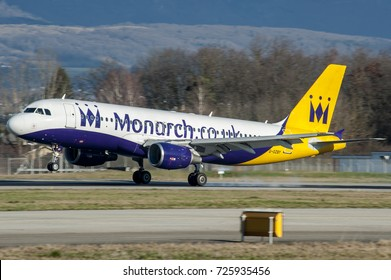 GENEVE COINTRIN AIRPORT - February 21, 2016. Airbus A320 Monarch landing at Geneve, Switzerland. This chareter company based on Luton, near London, is failed the October 2 2017. Airline ceases trading