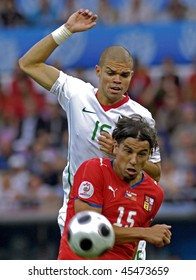 GENEVE - JUNE 11: Milan Baros n.15 of Czech Republic and Pepe n.15 of Portugal during the match Czech Republic - Portugal 1:3 Euro2008 Group A June 11, 2008, Stade de Geneve, Geneve, Switzerland