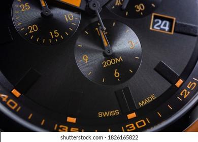 Geneve, Switzerland 01.10.2020 - Claude Bernard man swiss made watch AQUARIDER CHRONOGRAPH black dial close up detail. date indication 24. swiss made label MONTRE EDOX group