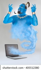 genie of the lamp with smoke from laptop isolated on grey