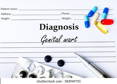 Genital wart -  Diagnosis written on a piece of white paper with medication and Pills