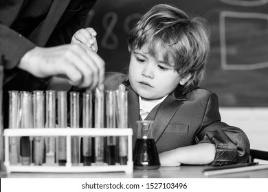 Genius pupil. Education concept. Talented scientist. Boy test tubes liquids chemistry. Chemical analysis. Knowledge day. Kid study chemistry. Experimenting with chemistry. Biotechnology and pharmacy.
