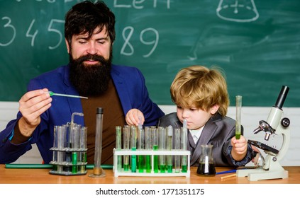Genius toddler private lesson. Genius kid. Teacher child test tubes. Chemical experiment. Genius minds. Signs your child could be gifted. Joys and challenges raising gifted child. Special and unique.