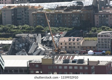 Genoa, 15 August 2018: large cranes of Vernazza, together with the firefighters, look for the missing in the rubble of the Morandi bridge, which on 14 August 2018 collapsed after a violent storm.