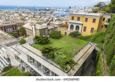 Genoa city with buildings and harbor - View with part of Genoa city and its famous, antique harbor, seen from the Spianata di Castelletto, Italy.