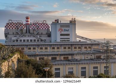 Genoa, Genova, Italy - January 2019: Enel old coal power station nearby Lanterna lighthouse in the port of Genoa, industrial landscape