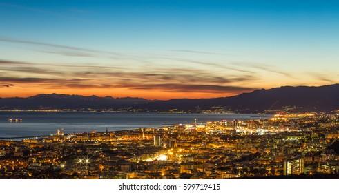 GENOA (GENOVA), ITALY, MARCH  10, 2017 - Aerial view of the city of Genoa (Genova) at dusk.