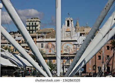 Genoa. Italy. 04.05.2019. The upper road and the BIGO. Cars on the elevated road. In the foreground the structure of the BIGO and in the background the Palazzo San Giorgio.