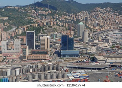 GENOA, ITALY - AUGUST 27, 2018 Italy, aerial view of Genoa industrial structures of the harbor, the major Italian seaport, with the Matitone (big pencil, literally) skyscraper