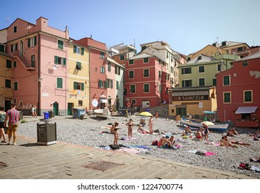 GENOA, ITALY - AUGUST 28, 2018 Boccadasse is a Genoa quanter and looks like a small fisher village surrounded by a big city grown around a bay with a pebble beach where people relax sunbathing