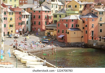 GENOA, ITALY - AUGUST 28, 2018 Boccadasse is a Genoa quanter and looks like a small fisher village surrounded by a big city grown around a bay with a beach, where people relax, enjoy the sun and swim