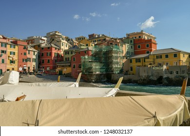 Genoa / Italy - February 12 2018: The old fishing village of Boccadasse, a famous quarter of Genoa, with boats on the quayside and colored houses on the little beach, Liguria