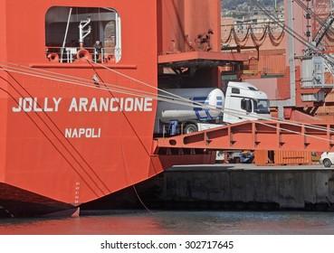 GENOA, ITALY - FEBRUARY 21, 2013: The cargo ship Jolly Arancione type Ro Ro Container Carrier registered in Italy with shipping company Messina. Embarkation of heavy vehicles.