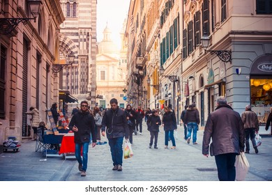 GENOA, ITALY - FEBRUARY 27, 2015: Tourists and locals walk near Cathedral of Saint Lawrence at the old city centre of Genoa, Italy