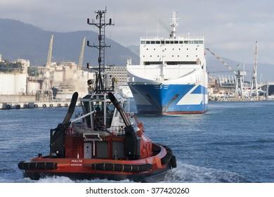 GENOA, ITALY - FEBRUARY 5, 2016:GENOA, ITALY - February 5, 2016: Ferryboat ro ro Eurocargo Livorno - Grimaldi Group, enters the port of Genoa