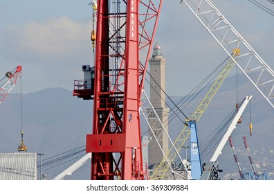 GENOA, ITALY - JANUARY 21, 2016: The lighthouse dominates the commercial docks of the port of Genoa. In the picture, cranes in the harbor dominated by the lighthouse.