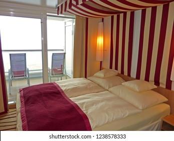 GENOA, ITALY - June 01, 2017: Luxury interior of a balcony cabin aboard AIDA perla