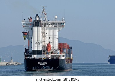 Genoa, Italy - june 04, 2015. A cargo ship leaves the port.