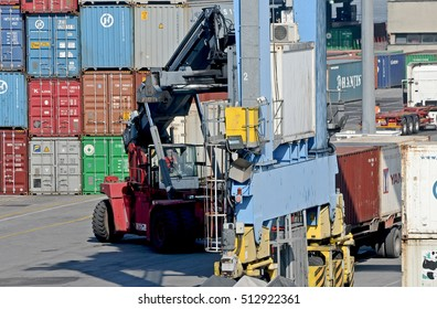 GENOA, ITALY - JUNE 25, 2013: forklift at work in the container terminal.