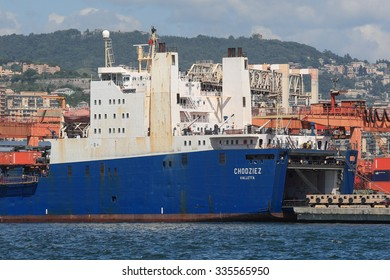 Genoa, Italy June 5, 2014: The cargo ship RoRo Chodziez of 15.666 tons, the port of Genoa for the collection of military vehicles.