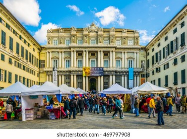 GENOA, ITALY, MARCH 13, 2016: people are enjoying sunny day on the square raffaele de ferrari in front of the palazzo ducale Genoa, Italy