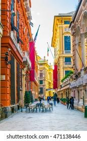 GENOA, ITALY, MARCH 13, 2016: people are walking along famous genovese palaces through via garibaldi street in the italian city genoa.