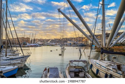 GENOA, ITALY - MARCH 20, 2021: View of port of Genoa with Porto Antico, boats and the colorful houses on italian coastline.