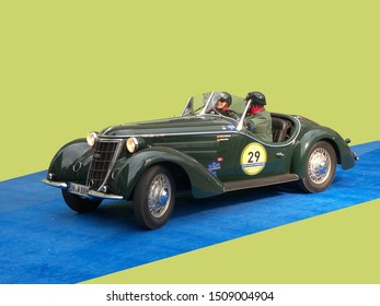 GENOA, ITALY - March 2009: Historical race Milan-Sanremo. This green car seems to come out of a dream. The car has been made in 1936. The car is an Auto Union Wanderer W2.