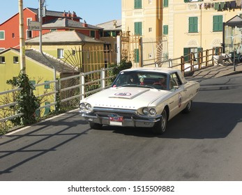 GENOA, ITALY - March 2009: Historical race Milan-Sanremo. White Urban vehicle, Ford car brand, model Ford Thunderbird, year 1964.