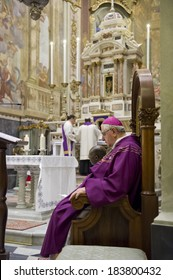 GENOA, ITALY - MARCH 22, 2014: Bishop and priest officiating Mass for confirmation in the Church of Santa Maria dell'Assunta in Sestri Ponente, Genoa, Italy.