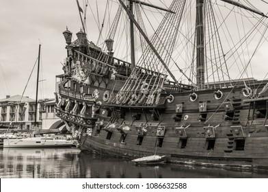 Genoa, Italy - May 14, 2017: Galleon Neptun in Porto antico in Genoa, Italy. It is a ship replica of a 17th century Spanish galleon built in 1985 for Roman Polanski's film Pirates. B&W photo.