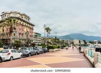 Genoa, Italy - May 14, 2017: People are walking along the Corso Italia street in Genoa, Italy. Corso Italia is the main promenade of Genoa, Italy.