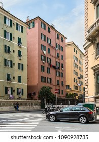 Genoa, Italy - May 14, 2017: Street life and typical architecture in Genoa, Liguria, Italy. The laundry is dried on the windows.