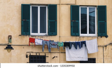 GENOA, ITALY - NOVEMBER 04, 2018 - Linen, clothes to dry is hanging from the windows on the streets of the city
