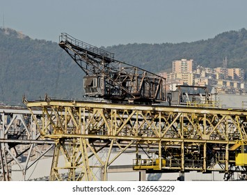 GENOA, ITALY - OCTOBER 16, 2009: Industrial archeology in the port city. In the picture the old crane on the quay.