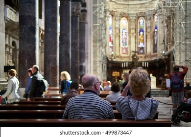 GENOA, ITALY - OCTOBER 9, 2016: Old couple sits down in the Cathedral of St. Laurence to admire its decoration and take some pictures