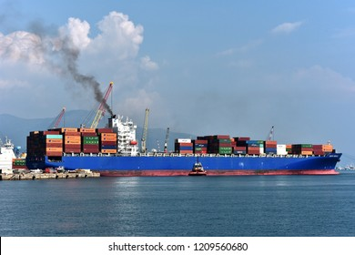 Genoa, Italy - September 19, 2018: the container ship SANTA REGULA built in 2005 currently is  sailing under the flag of Liberia; performs docking maneuvers with the help of tugboats