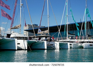GENOA, ITALY - SEPTEMBER 21, 2017: 57th edition of the International Boat Show. In the picture, sail catamarans in the fair harbor.