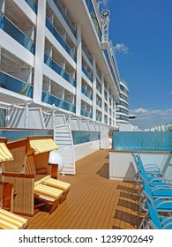 GENOA, ITALY - View over Lanai Deck of AIDA perla with beach chairs and hot jacuzzi to relax