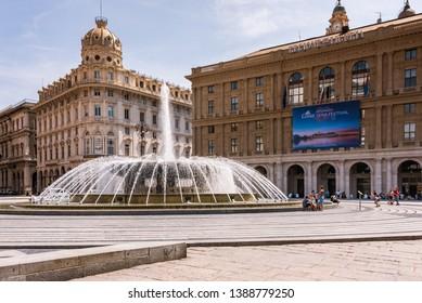 Genoa, Liguria / Italy - 07 08 2018: Piazza Raffaele de Ferrari - the heart of the city, the headquarters of the Ligurian Region Liguria, Palazzo dell` Accademia Ligustica, fountain
