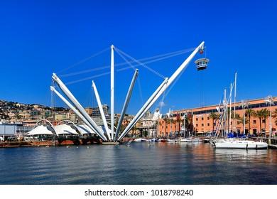 Genoa, Liguria / Italy - 2012/07/06: panoramic view on the port and city of Genoa and Genoa Aquarium entertainment complex - panoramic lift