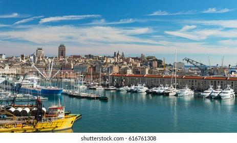 Genoa, Liguria, Italy - February 26, 2017: Serene panoramic view of old port in Genoa the major Italian seaport on the Mediterranean Sea with cityscape of Genoa town.
