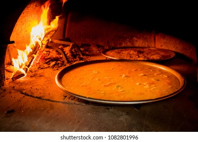 Genoese farinata is a historical recipe from Liguria prepared with chickpea flour combined with water, flour and salt. Cooking in a wood oven
