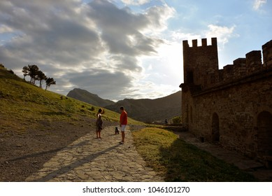Genoese fortress the city of Sudak. Crimea. Types of fortress at sunset, landscapes with a fortress, view from the fortress to the sea. View of the sky at sunset. Romance and knightly themes.